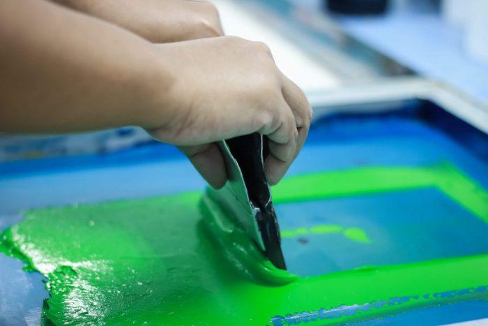 Silk screen printing in process